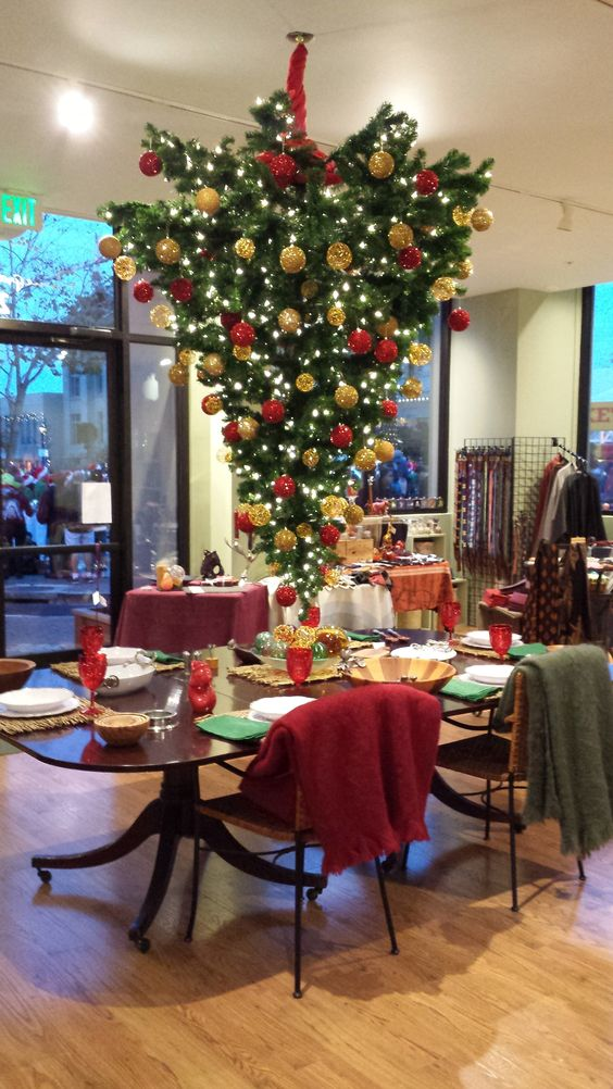 Upside down Christmas Tree over the dining room table in the Pomegranate Seeds store.
