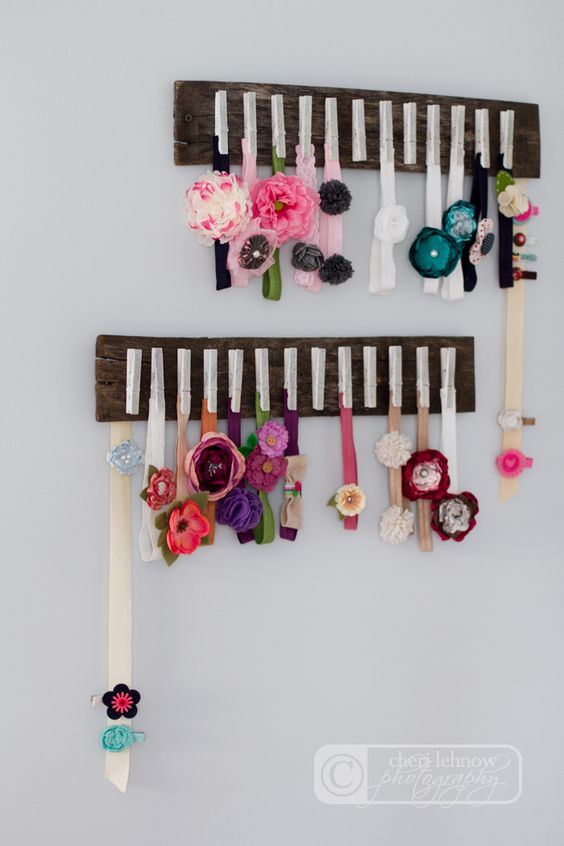If Abbi is anything like I was as a newborn, she probably won't have much hair, so I'm sure we'll have a lot of headbands.  Very pretty and organized way to store headbands and clips!: