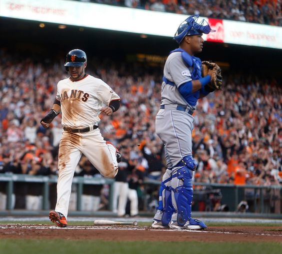 San Francisco Giants' Gregor Blanco scores on a single by Hunter Pence in the first inning of Game 4 of baseball's World Series at AT&T Park in San Francisco, Calif., on Saturday, Oct. 25, 2014. (Nhat Meyer/Bay Area News Group)