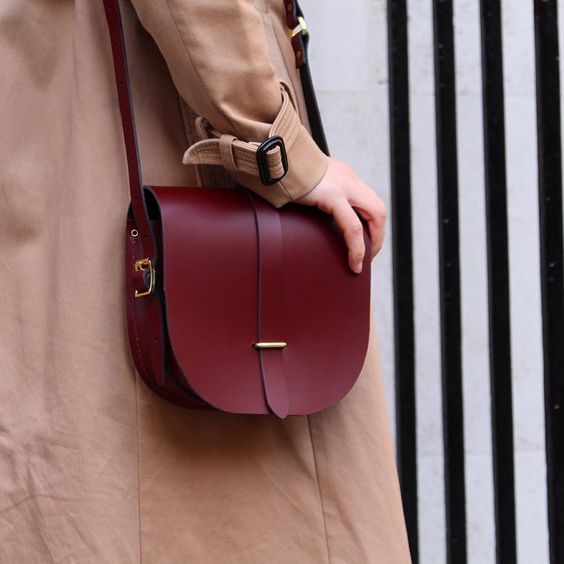 A traditional bag in one of our best-loved colours: The Saddle Bag in Oxblood. The perfect partner to classic trench coats and stripey tees #cambridgesatchel #cambridgesatchelcompany: