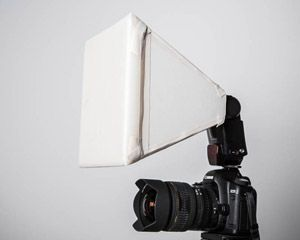 Build your own camera flash softbox (helps diffuse harsh lighting you get with regular flash).