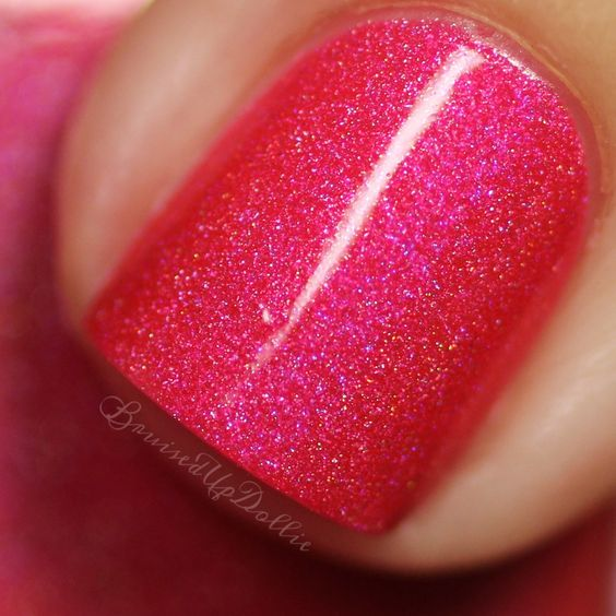 Colors by llarowe Spring 2016 - You Make Me Smile is a bright almost neon pinky coral soft linear hologrpahic with blue/purple shimmer. Swatch by @bruisedupdollie.