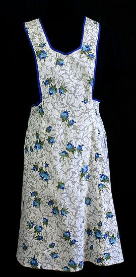 Cotton print apron, c.1950  This charming floral print apron slips on over the head and ties in back at the waist. The apron has a patch pocket on one side.