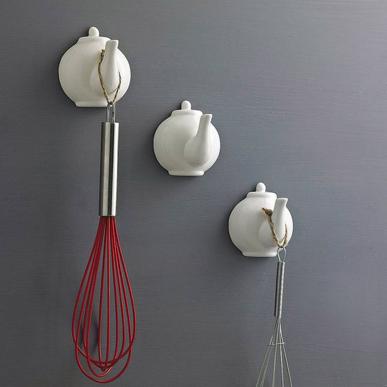Fun idea: Ceramic Tea Pot Spout hooks. For purchase too.