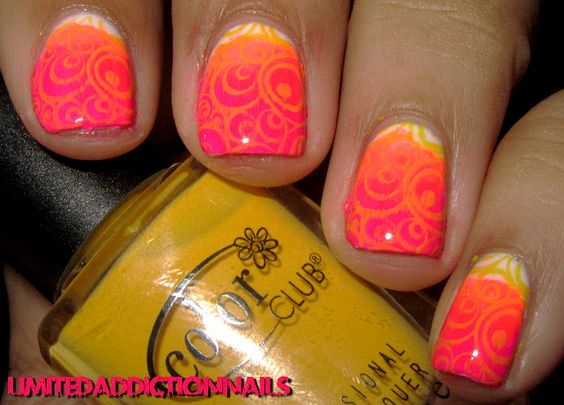 White, orange and hot pink with stamped design in yellow/orange.