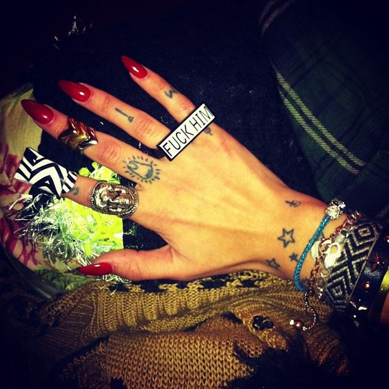 tattoo. I luvvvv my new ring from @realmisskl FUCK HIM - @barbiebeth- #webstagram