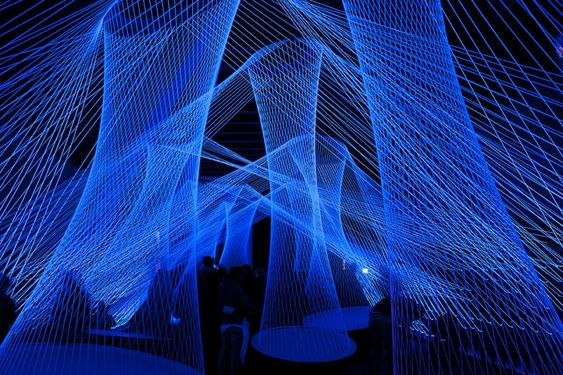 Luminale Frankfurt  Interactive Light and Sound Installation white elastic that can be played like a guitar