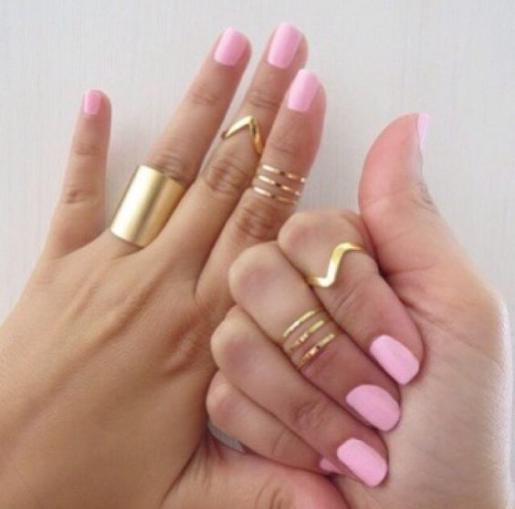 Baby pink nails and gold rings