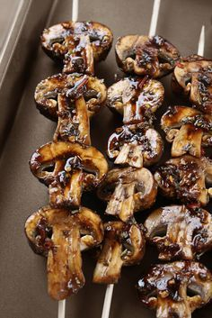 Marinated & grilled mushrooms. an awesome side dish with steaks! Love the skewer idea!