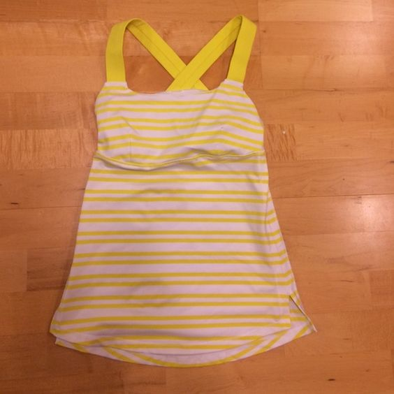 Nwot Lululemon tank workout top yellow white 2 x5 Nwot Lululemon tank workout top in yellow and white stripes. Size 2 called  x5. Built in bra top with holes on side to add padding and a key holder. Never worn but took off tags. Too small in my bust. lululemon athletica Tops Tank Tops