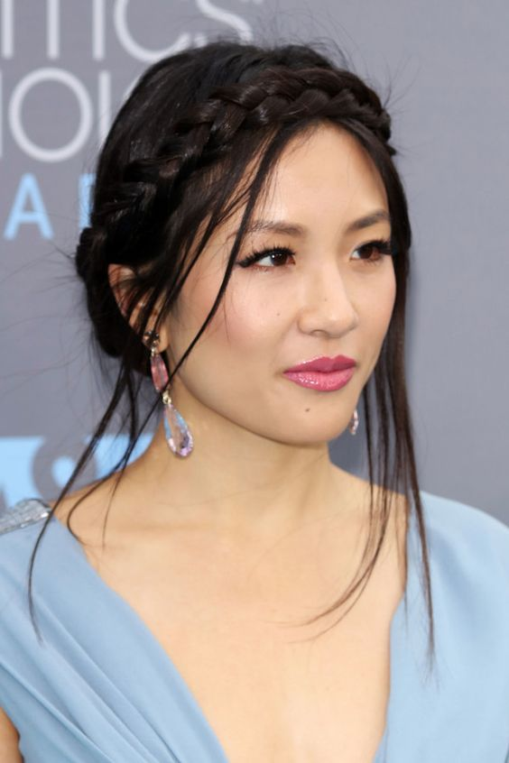 Constance Wu's Romantic Crown Braid - The romance is in Constance's messy texture and loose wispypieces. To copy her look, pull out a few strands to frame the face and back-comb the braid to createa lived-in look.