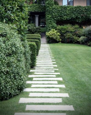 Large slabs of concrete make a stepping stone path