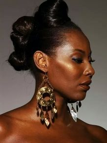 ANUROCKMETAL.NET NKRUMAH JENNINGS, KODWO NWALA Brass, copper and silver earrings with bubble texture and brass chains.