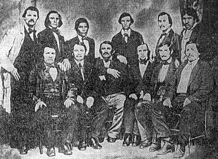Delaware Delegation to Washington D.C. - 1867 Standing L-R: James McDaniel (Cherokee), Black Beaver (Delaware), Henry Tiblow (Interpreter), John G. Pratt (Indian Agent), Charles Armstrong (Delaware), John Young (Delaware) Sitting L-R: James Ketchum (Delaware), James Conner (Delaware), John Conner (Delaware), Charles Journeycake (Delaware), Isaac Journeycake (Delaware), John Sarcoxie Sr. (Delaware)