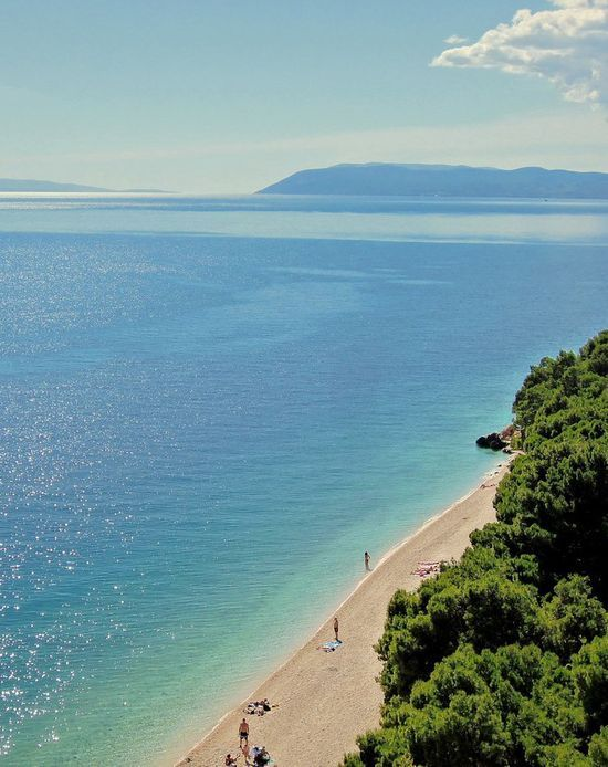 Makarska Beach, Croatia. Makarska is one of the best tourist destinations on the Croatian coast, because of its long sandy beach, walkways with pine trees, comfortable private and hotel accommodations.