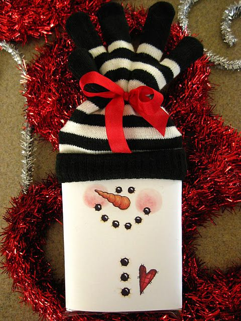 Wrap candy bar in white paper. Draw snowman face. Tie the ...