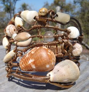 Hand gathered shells from a remote beach in South Kona Hawaii. Reclaimed copper wire from an Electric job. Inspired by the ocean waves and creatures.  I truck down a 4x4 road for 6 miles to get to this remote beach, camp out and shell hunt. I then bring my shell treasures home and start the careful shell drilling.                                                                       Handmade by Carmen