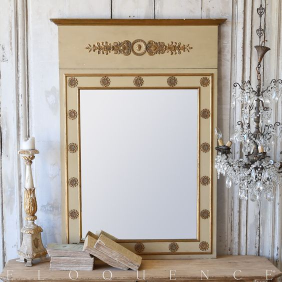 Eloquence® Antique Trumeau Mirror Splendid Old Original Glass Mirror from France. Directoire Style Carvings in a neutral Beige painted finish with Gold Gilt Highlights.