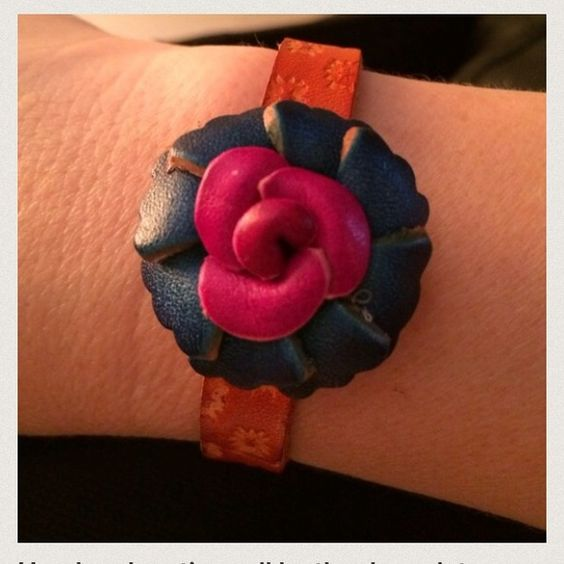 Host PickHandmade artisan all leather bracelet BeautifulHand tooled and created quality craftsmanship all leather bracelet.  Beautiful leather flower, deep, rich colors.  Two snaps closure allows for size adjustment to fit any wrist. Accessories
