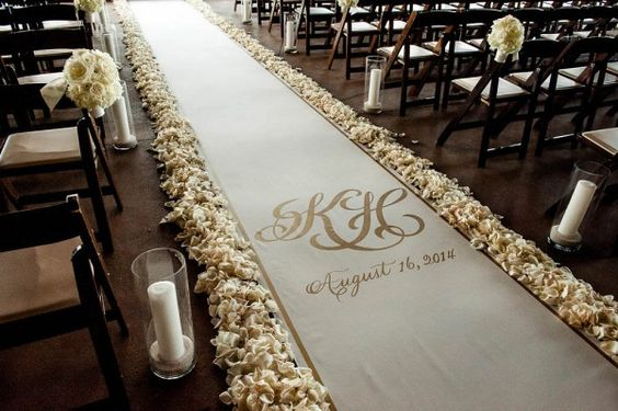 Monogrammed aisle runner with flower petal border | Photo by Jennifer Lindberg via http://junebugweddings.com/wedding-blog/what-junebug-loves/elegant-gold-wedding-barton-creek-resort/