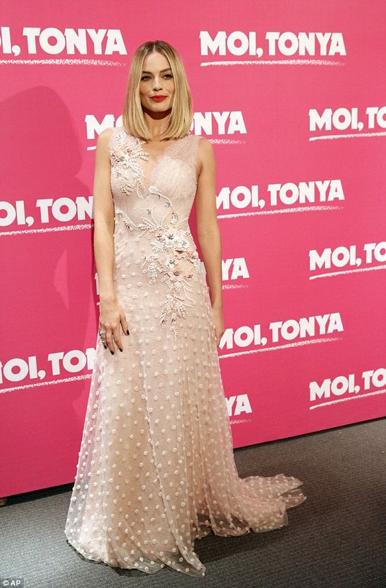 Glamorous: Margot Robbie was looking incredible when she attended the Paris premiere of I, Tonya on Monday night, donning a beautiful embroidered gown