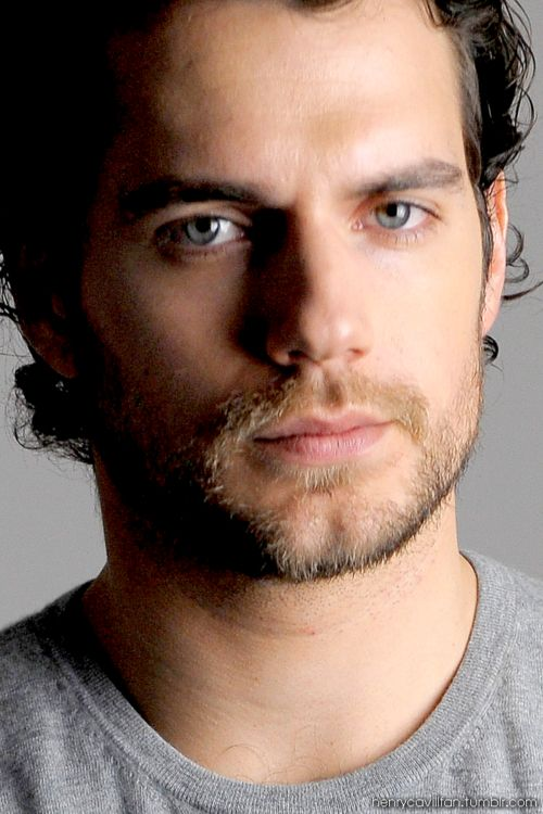 I'm dumbfounded, lost in his striking baby-blues. Looking up into his gorgeous face, I take in his chiseled jaw, cleft chin, and mass of dark curls. He's the perfect combination of pretty and sexy. His strong nose, distinguished cheekbones, and full lips shaped to perfection.