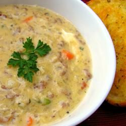 This is a rich soup in which ground beef is sauteed in butter with vegetables and herbs prior to adding milk, cubes of cheddar cheese and sour cream.