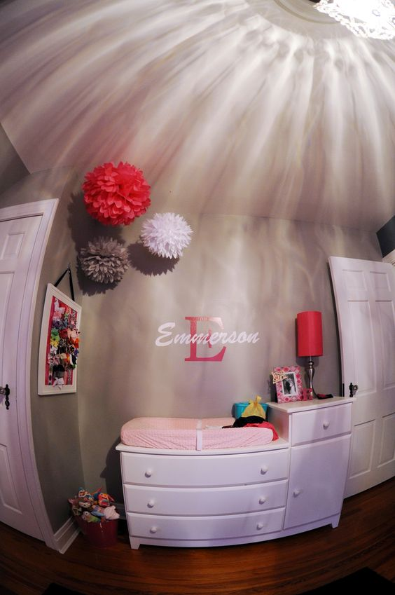 We made the bow holder & her daddy painted her name on the wall