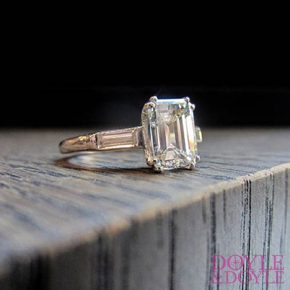 Vintage emerald cut diamond engagement ring with baguette sides