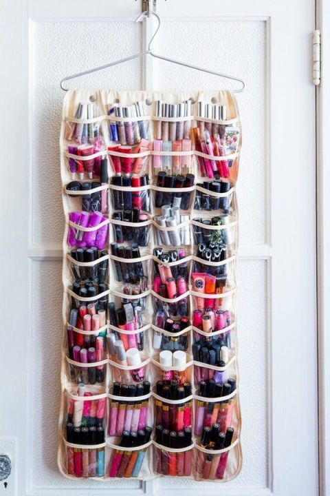If you have a huge makeup collection (lucky!), you know it's nearly impossible to find enough space to keep everything. A shoe organizer on the back of your door offers space for all of your lipsticks, nail polishes, and whatever else you own. See more at Salto Quinze »