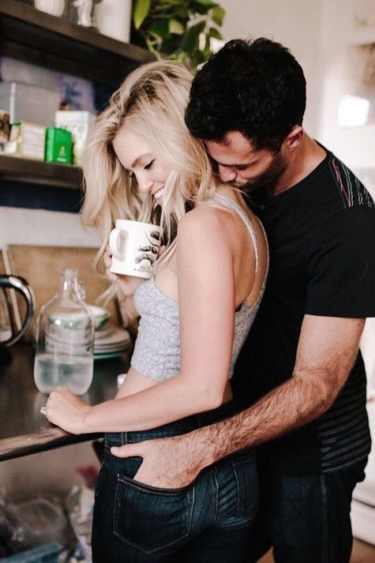 Couple cuddling in kitchen