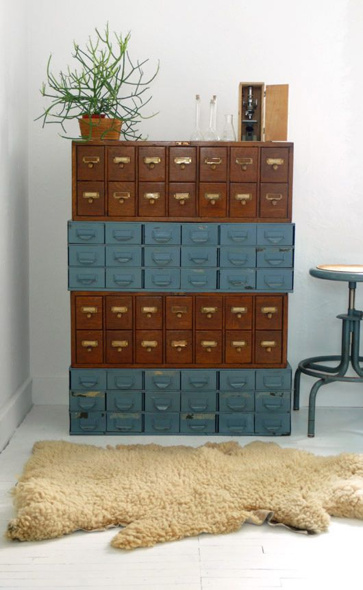 "The ultimate storage for tiny things by painting some and stacking old library card catalog drawers, one on top of the other, to make an awesome and functional ""furniture piece"".:"