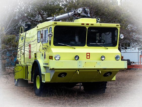 An Old Air Force Airport Fire Truck On Display At The