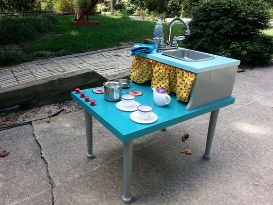 Our kids plays and repurposed on pinterest for Play kitchen table
