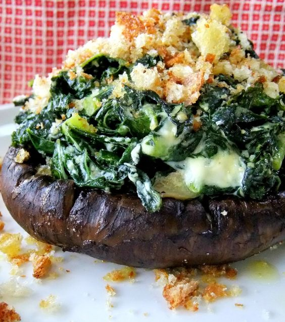 grilled portobello mushrooms stuffed with kale, goat cheese, and bread crumbs