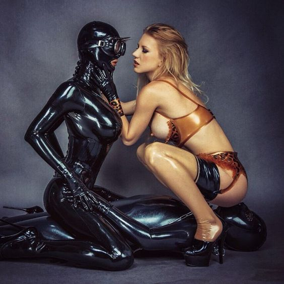 kyliemarilyn:  Good morning everyone. Let's begin the new week sexy and with lots of latex. Bizarrlady Estelle, me and her slave having fun in a spontaneous shooting at Studio Black Fun in Leipzig, Germany. Hope you like it. More to come soon. xoxo Kylie Marilyn The lingerie is from Simon O, my catsuit and corset from Fantastic Rubber and the hood by Rubber55.  (at Studio Black Fun, Leipzig, Germany)
