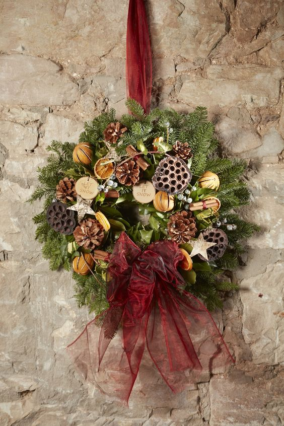 Fragrant festive wreath with dried fruit and cinnamon, plus lotus heads and wooden accessories, using our foam ring and organza