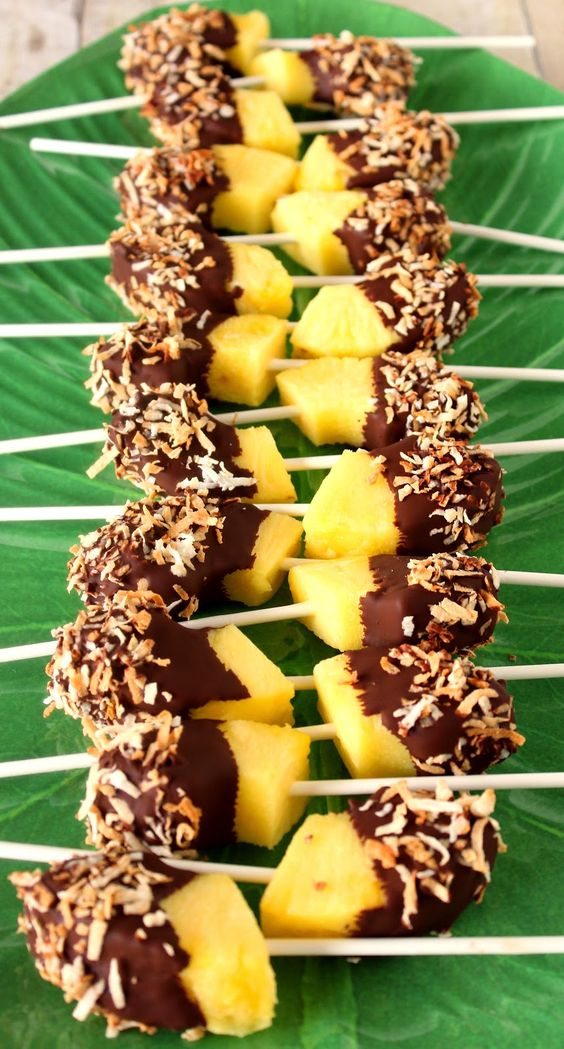 Frozen chunks of pineapple are dipped in dark chocolate and sprinkled with toasted coconut. AWESOME!!