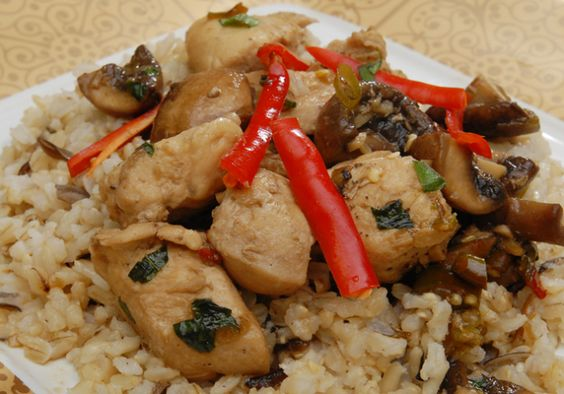 Stir-fried chicken with basil, mushrooms and chilies