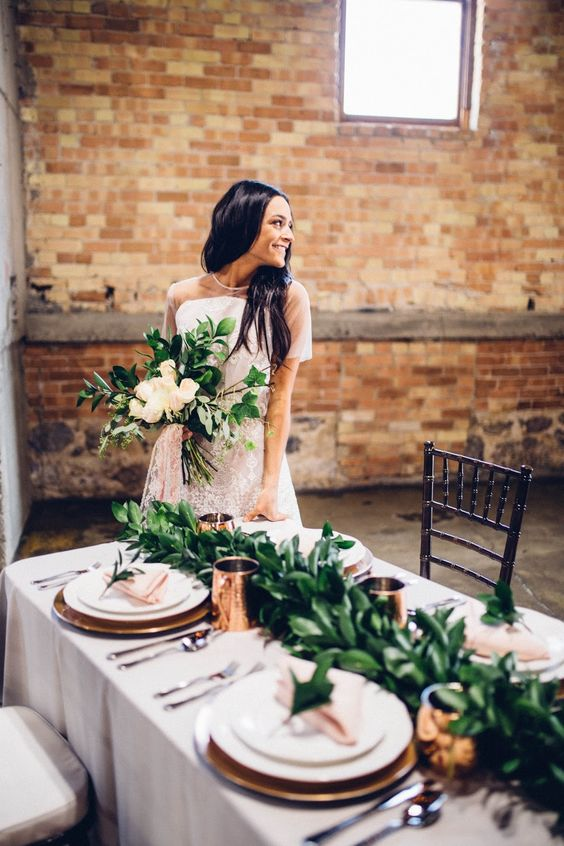 I am so in love with this table set up. I love the copper mugs and blush napkins! Industrial Wedding Copper, greenery, brick, stylized shoot, grey tablecloth, blush wedding