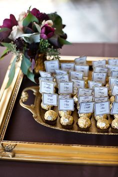 Candy Placecards- use ferero rocheres to make placecards. You will need, place cards in pearly ivory card, with gold edging and black writing, cocktail sticks and sticky tape.
