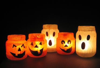Lighten Up!  Put tea lights into old mason jars (or baby food jars) and add a spooky face.