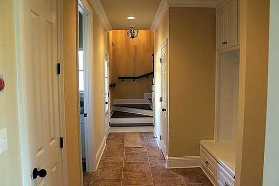 Mud Room - with view of stairway to bonus room above 3-car garage