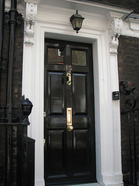 High gloss black door with glass top panel + brass hardware: