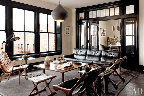 Design by Roman and Williams Buildings and Interiors.  [the dramatic framed black doors]
