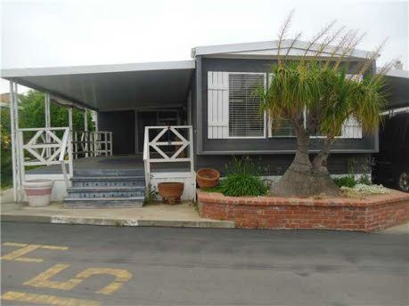 Beautiful porches for single wide trailer houses joy for Mobile home with wrap around porch