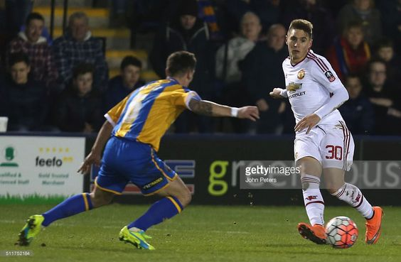Guillermo Varela of Manchester United in action with Ian Black of Shrewsbury Town during the Emirates FA Cup Fifth Round match between Shrewsbury Town and Manchester United at Greenhous Meadow on February 22, 2016 in Shrewsbury, England.