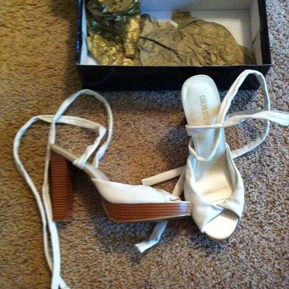 White strap lace up sandals **New** These are new in the box never been worn sandals. They are white with a wooden base and heel. They lace up the calf. Colin Stuart Shoes Sandals