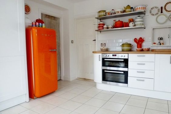 Our 1960s style vintage kitchen with orange SMEG from www.katebeavis.com
