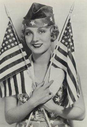 Leila Hyams looking patriotic, and even holding two 48-star versions of Old Glory: